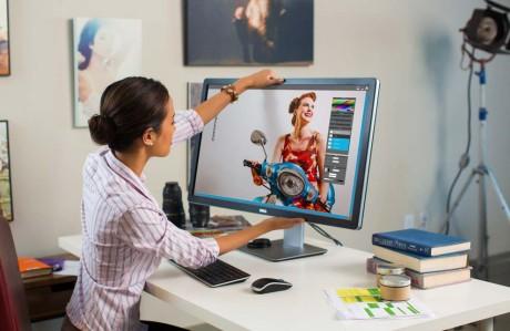 Woman Using UP3214Q Monitor at Desk