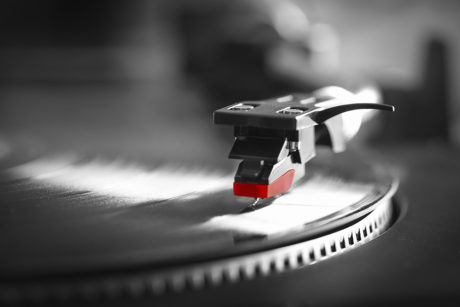 Record turntable playing vinyl record